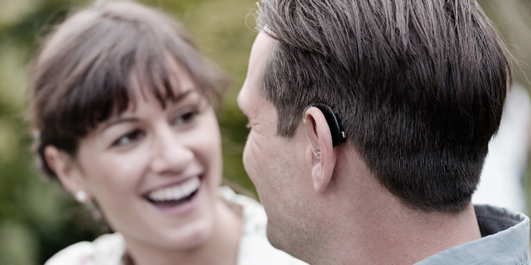 dynamo_hearing_aid_and_woman_smiling_and_man