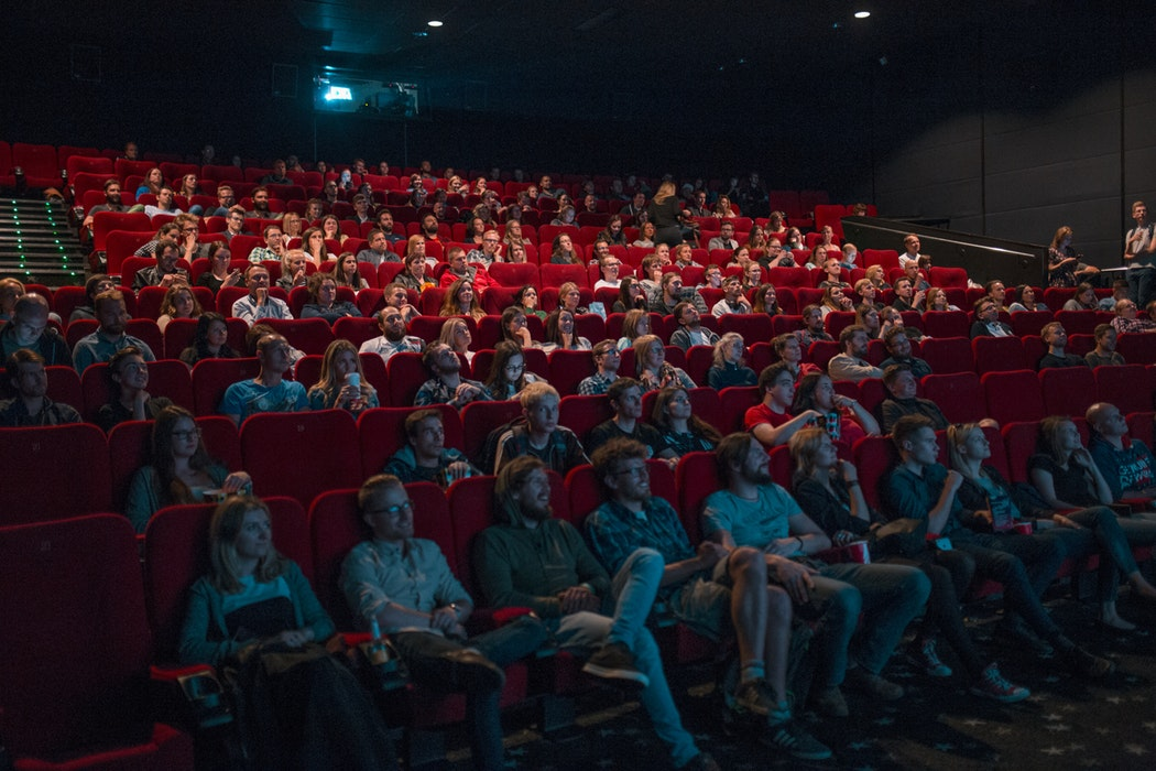 People_in_movie_theater_hearing_loss
